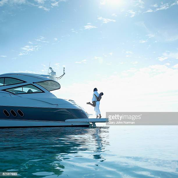 Couple on stern of power boat