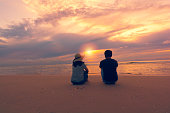 Couple on the beach at sunset time.