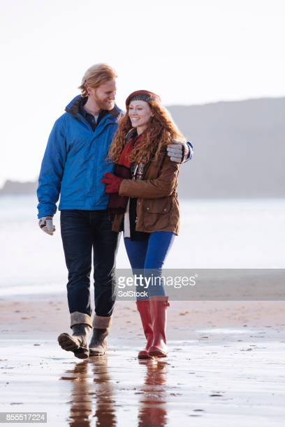 Couple on the Beach During Winter