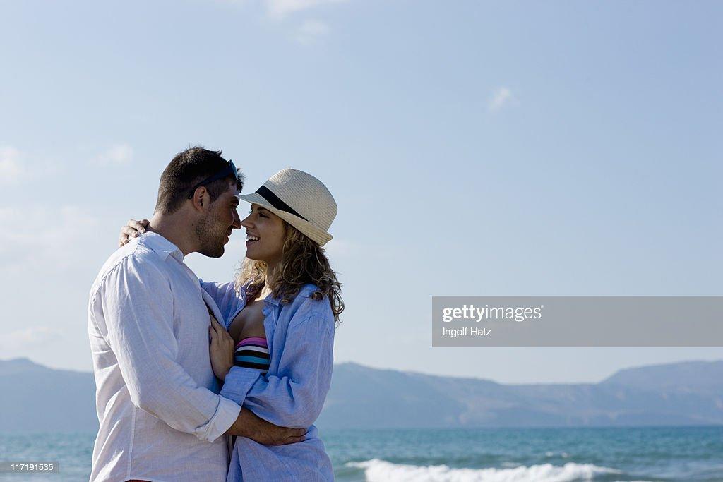 couple on the beach hugging : Stock Photo
