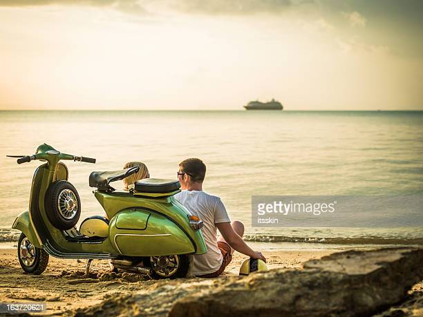 Couple on the beach with retro bike