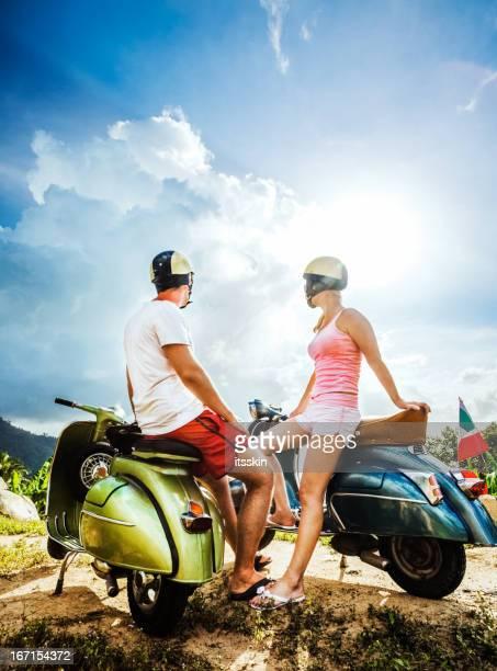 Couple on the mountain with retro bikes