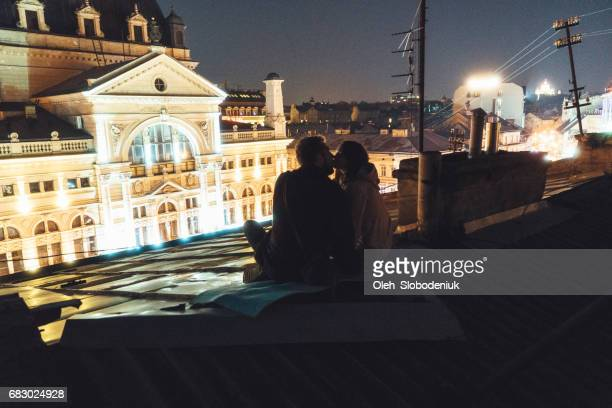 Couple on the roof at night