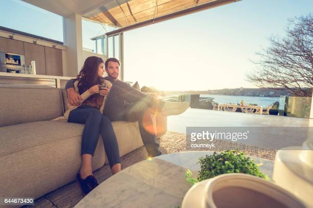 Couple on the sofa at sunrise.