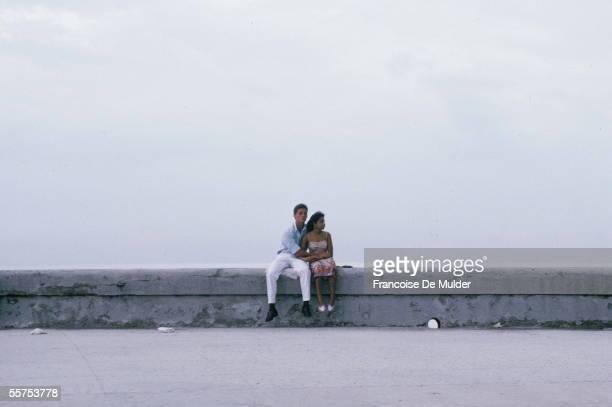 Couple on the walk of Malecon Havana on 1988 FDM1591