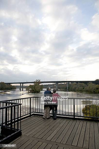 Couple on walkway above James River, Richmond, VA, U.S.A.