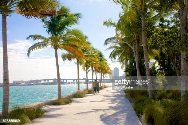 Couple on waterside promenade, Miami, Florida
