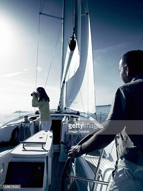 Couple on yacht with binoculars