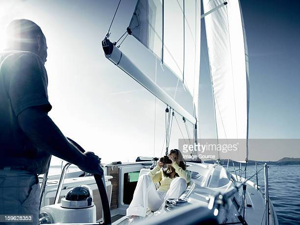 Couple on yacht with camera