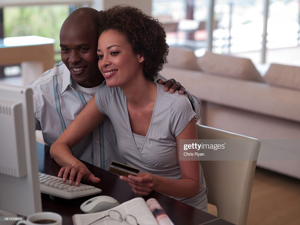 A couple online shopping : Stock Photo