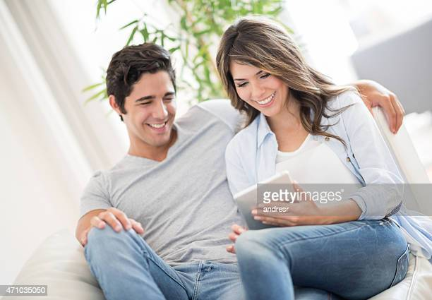 Couple online using a tablet computer