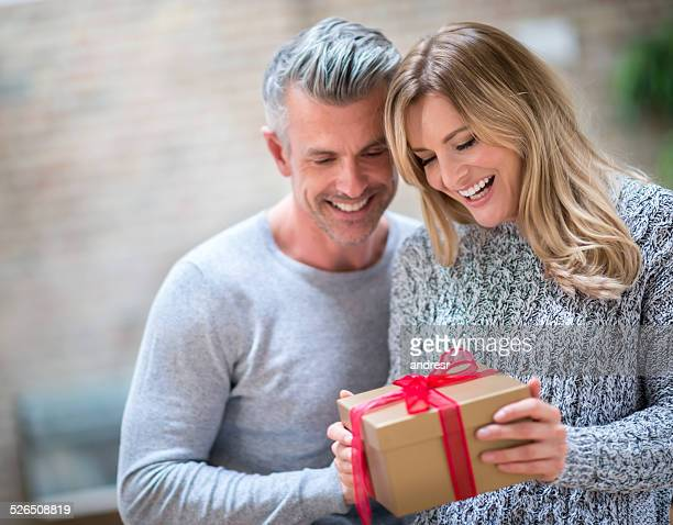 Couple opening a gift