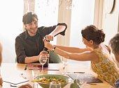 Couple opening wine bottle