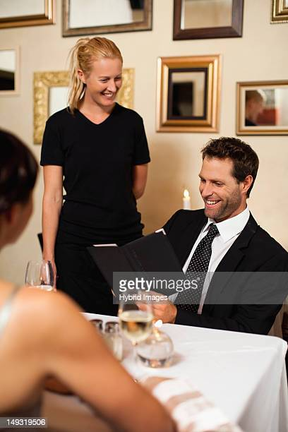 Couple ordering dinner in restaurant
