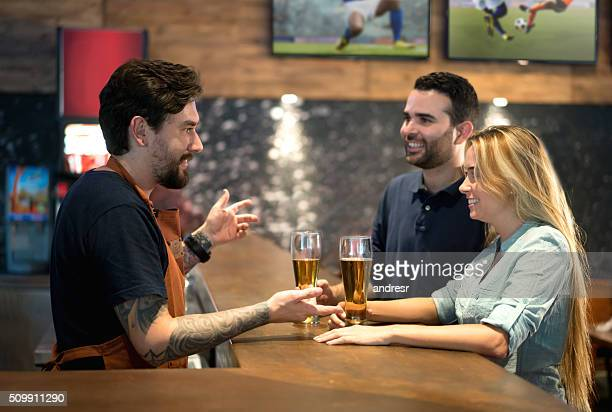 Couple ordering drinks at the bar