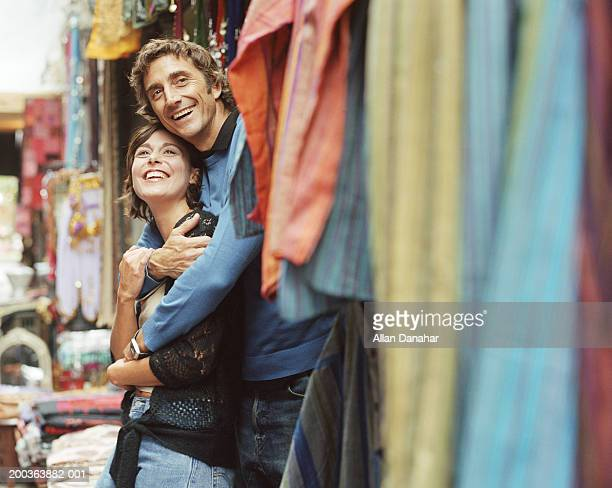 Couple outdoors at market, smiling