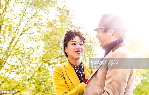 Couple outdoors in the sun in an autumn day