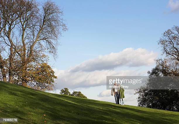 Couple outdoors walking on a hillside