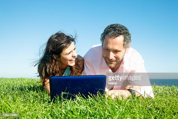 Couple outdoors with computer