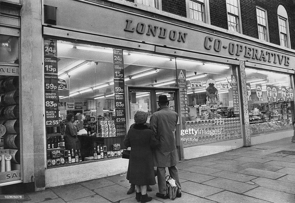 http://media.gettyimages.com/photos/couple-outside-a-london-cooperative-store-february-1973-picture-id102625376