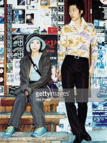 Couple outside a shop : Stock Photo