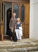Couple outside doors