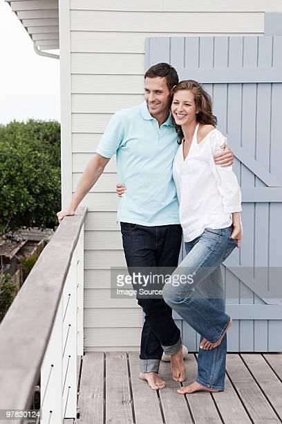 Couple outside holiday home