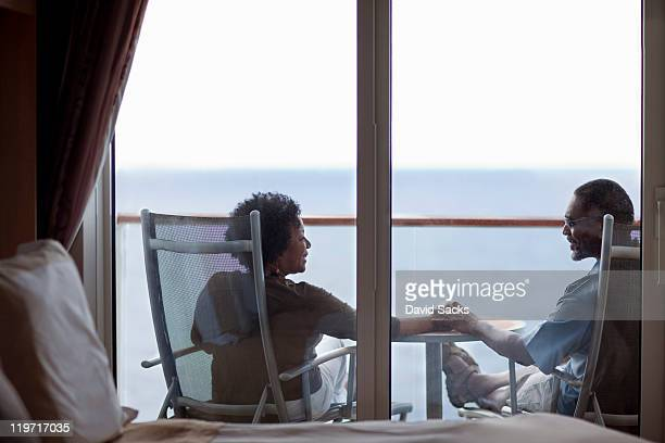 Couple outside their cruise ship bedroom