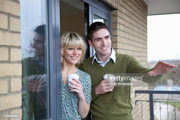 Couple outside their new apartment