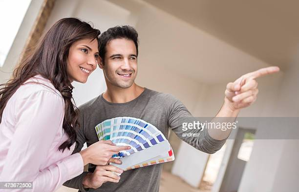 Couple painting the house and choosing the color