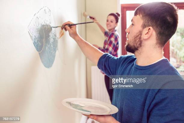Couple painting wall mural