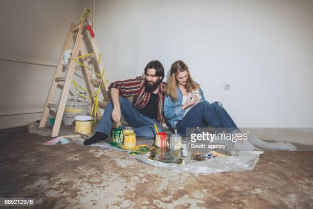 Couple painting with their cat