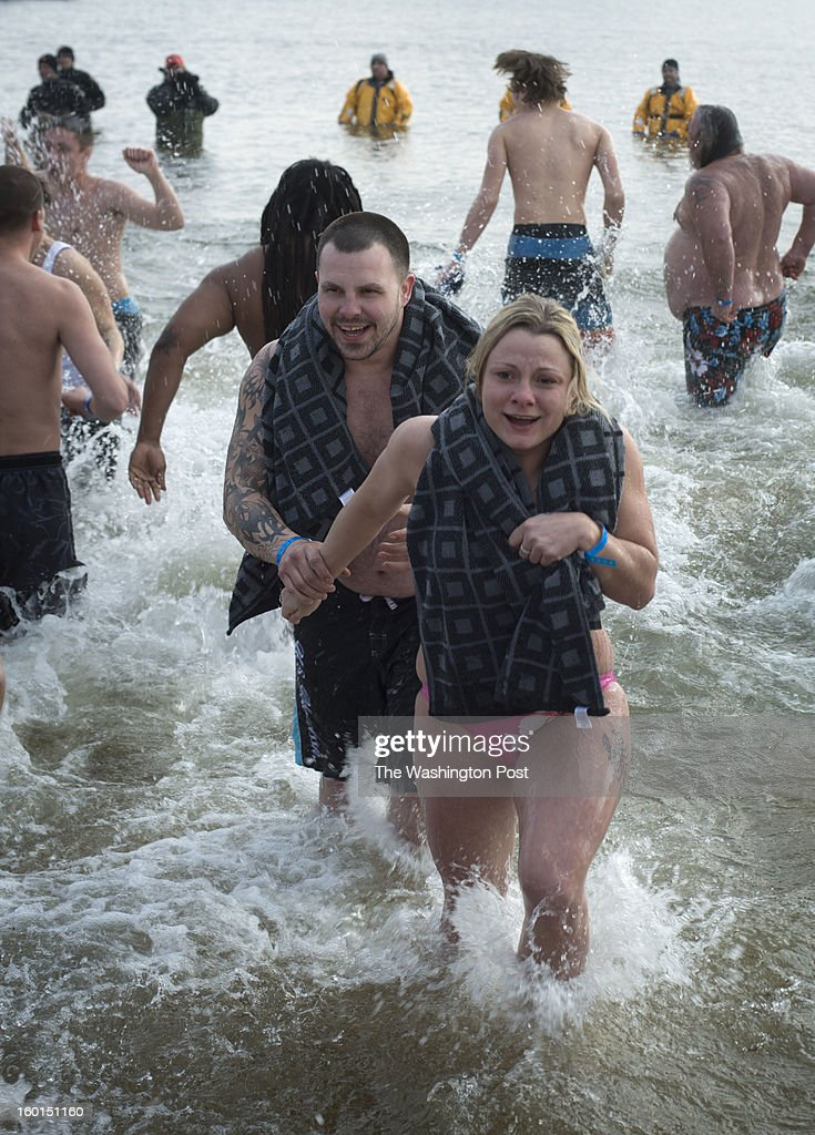 A couple participate in the 17th Annual MSP Polar Bear Plunge in the Chesapeake Bay on Saturday, January 26, 2013.