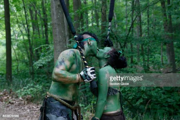A couple pause for a kiss as they pass each other during a woods battle at Ragnarok XXXII on June 22 2017 For one week each summer the World has come...