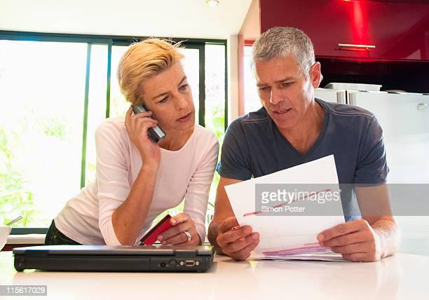 Couple pay bills