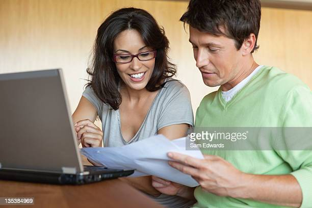 Couple paying bills on laptop together