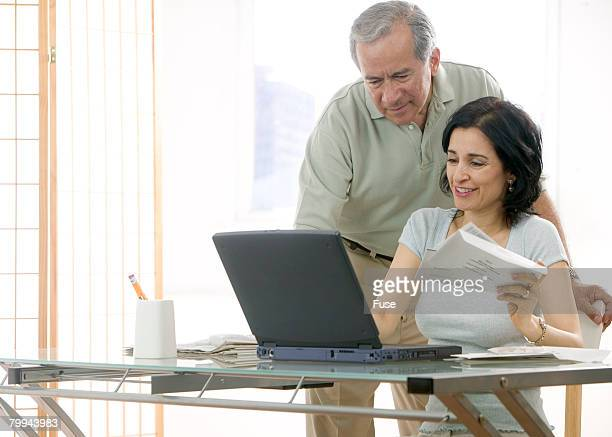Couple Paying Bills Online at Home