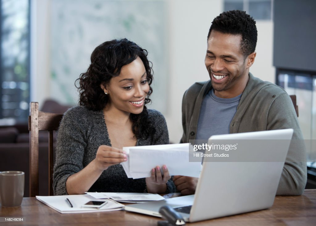 Couple paying bills together : Stock Photo