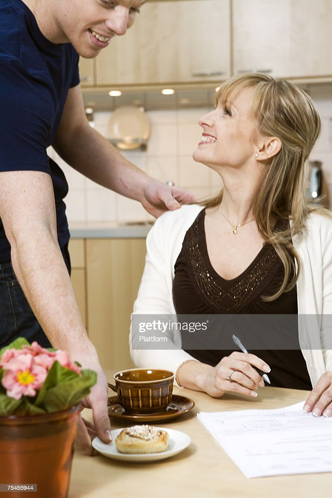 A couple paying their bills. : Stock Photo