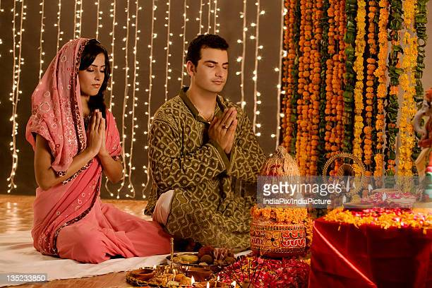 Couple performing a pooja
