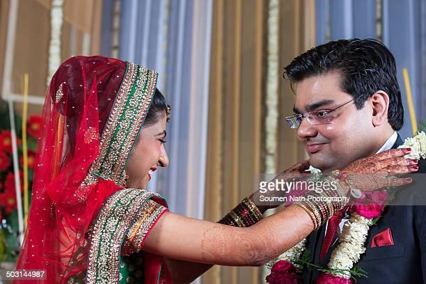 Couple performing Jaimala during their wedding