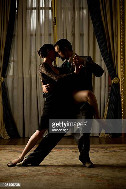 Couple performing Tango dance in ball room