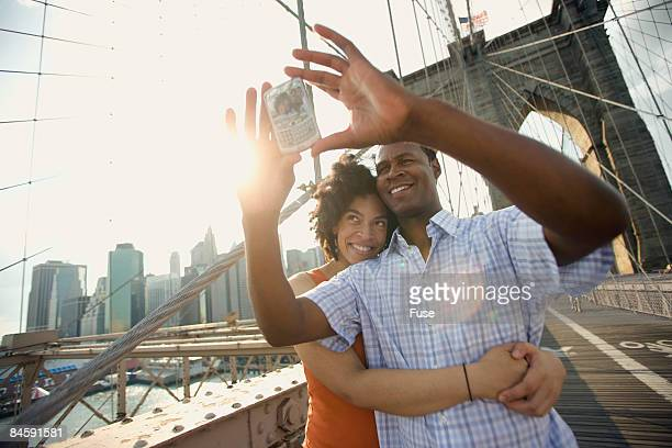 Couple Photographing Themselves on Brooklyn Bridge