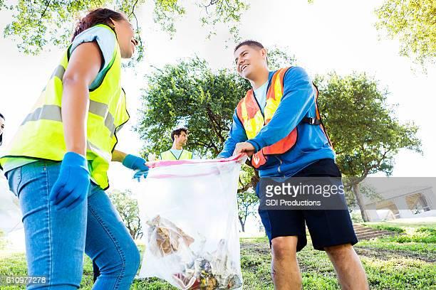 Couple pick up trash in neighborhood