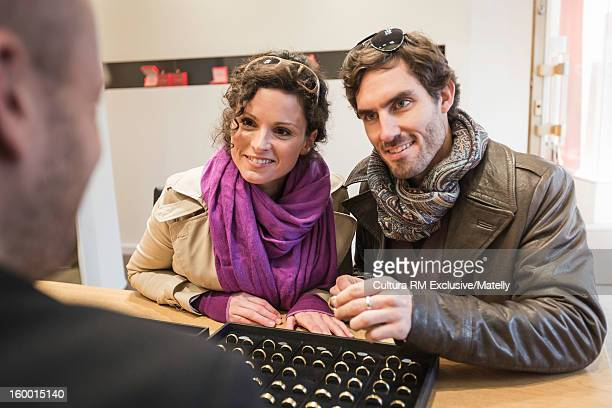 Couple picking out wedding bands
