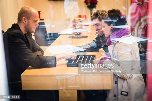 Couple picking out wedding bands : Stock Photo