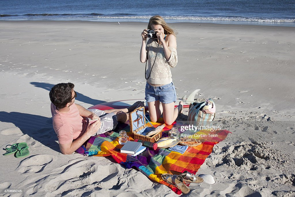 Couple picnicing and photographing, Breezy Point, Queens, New York, USA : Stock Photo