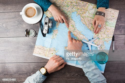 couple planning honeymoon : Stock Photo