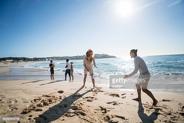 Couple playing badminton at the beach