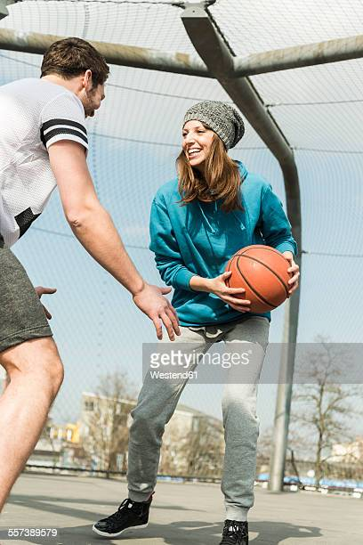 Couple playing basket ball
